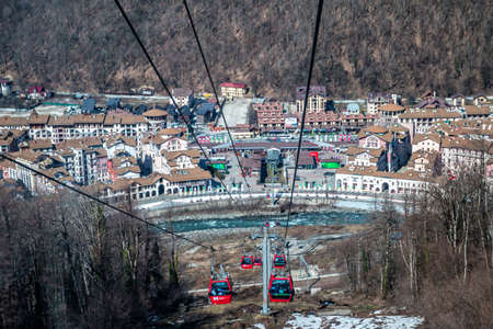 Sochi, Russia - March 31, 2021: Krasnaya Polyana Resort. View from Gondola lifts to the mountain Редакционное