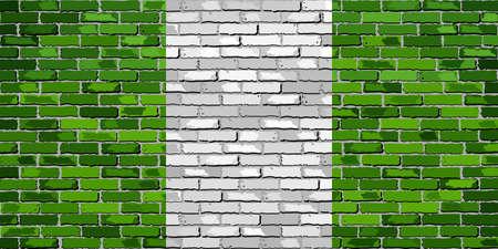 Flag of Nigeria on a brick wall.