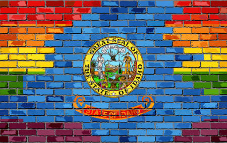 レンガの壁アイダホとゲイフラグ - イラスト、レンガのテクスチャの背景に虹の旗、抽象的なグランジアイダホフラグとLGBTフラグ