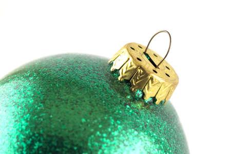 Green christmas glass ball on white background photo