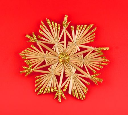 Isolated christmas decoration on red background (snow flake, octagon) photo