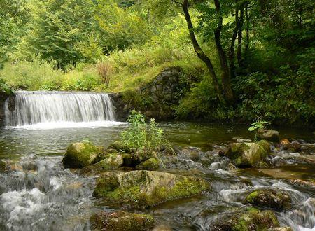 Mountain river stream. Waterfall. photo
