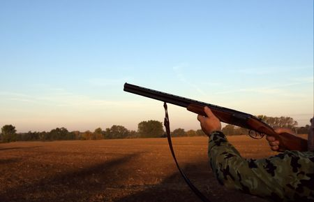 sunup: Hunter with shotgun (morning sun-up)