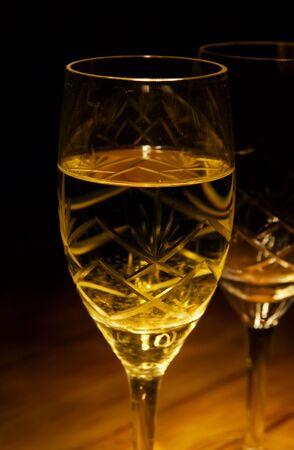 lowkey: Glass of white wine still life (low-key image)