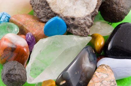 Heap of different rock crystals  (macor, close-up) photo