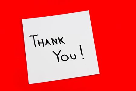 Thank you note isolated on red background photo