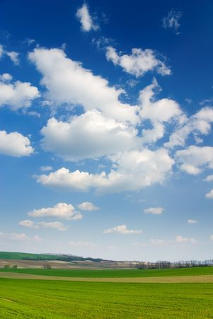 Large piece of land and blue cloudy sky (can be used how background or wallpaper) Stock Photo - 849182