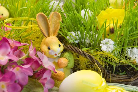 Easter still life - bunny close to wicker basket photo