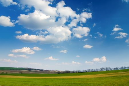 Large piece of land and blue cloudy sky (can be used how background or wallpaper) photo