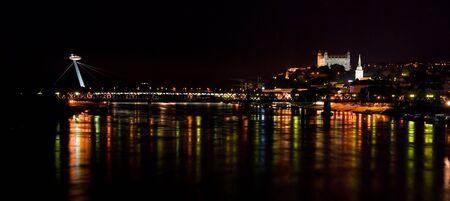 bratislava: Night view of Danube River through Bratislava in Slovakia Stock Photo