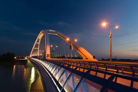 bratislava: Apollo bridge in Bratislava in Slovakia in the evening Stock Photo