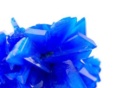 harmonize: Macro of blue vitriol isolated on white background