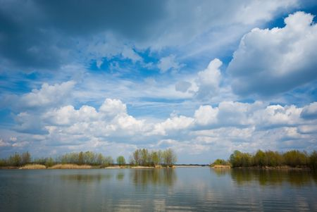 Cloudy sky and lake (can be use how background, wallpaper, texture) photo