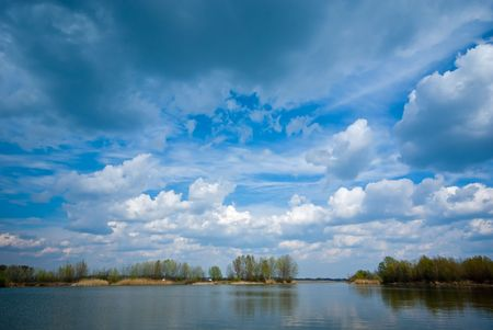 cloudy: Cloudy sky and lake (can be use how background, wallpaper, texture)