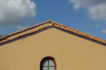 gable: gable roof and blue sky Stock Photo
