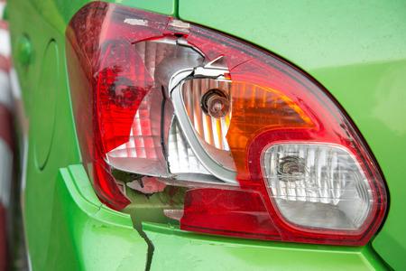 fender bender: Broken car rear lights.