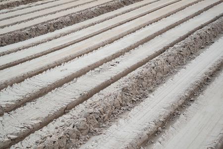 oblique: Fresh tractor traces in ground,Oblique line.