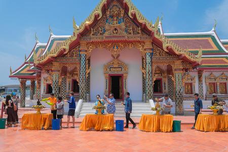 chum: SAKON NAKHON,THAILAND-APRIL 15,2015: People are pouring water onto Buddha image at Wat Pratat Choeng Chum in songkran festival. Editorial