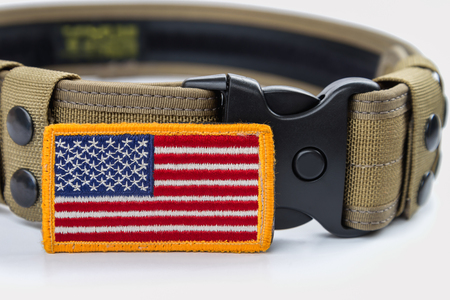 rounded: Rounded American flag patch and  tactical belt. Stock Photo