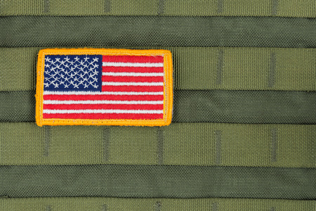 us military: Rounded American flag patch on U.S. military combat uniform,OD Color. Stock Photo