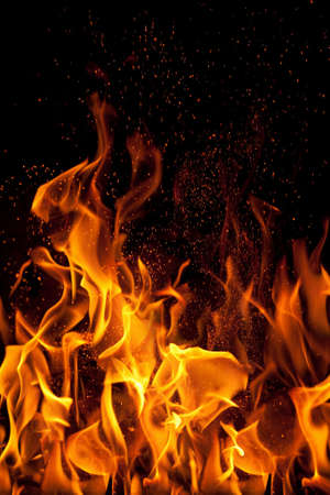 flame and sparks isolated over black background photo
