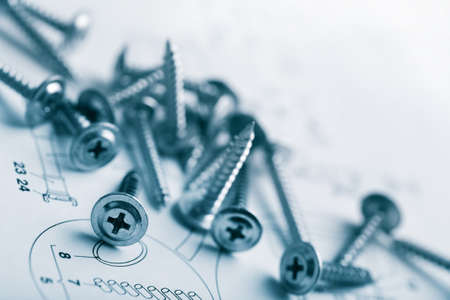 screw: metal screws over technical drawing background Stock Photo