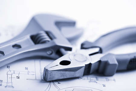 wrench and pliers over technical drawing toned blue Stock Photo - 4501416