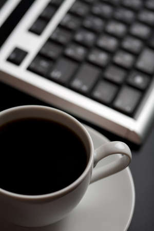 sprightly: cup of coffee and keyboard (shallow DOF) Stock Photo