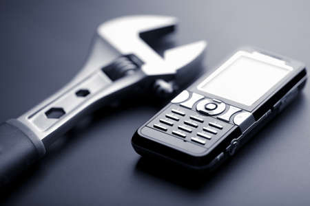 communicative: calling for help: mobile phone and wrench