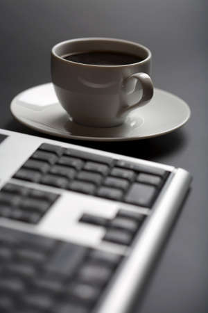 cup of coffee and keyboard photo