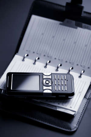personal organizer and mobile phone photo