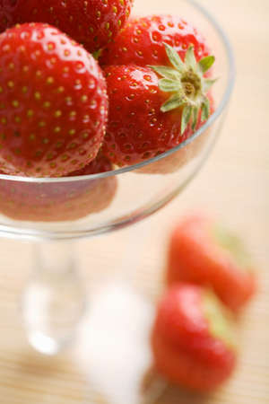 ripe strawberries in glass bowl photo