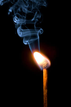 match burning with smoke isolated photo