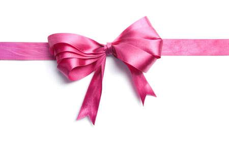 lazo rosa: cinta de color rosa con arco aislado Foto de archivo