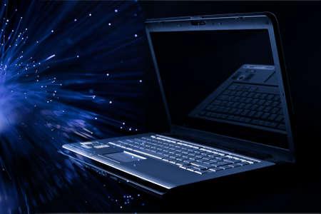optical equipment: modern laptop over black background