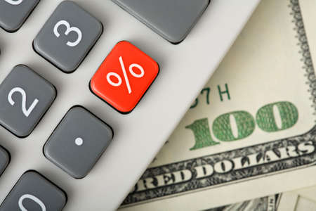 taxes budgeting: dollars and calculator with percent red button