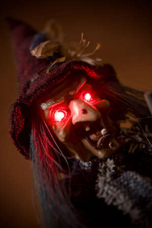 bedlam: witch puppet with red glowing eyes