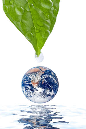 water drop falling onto earth planet isolated photo