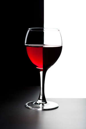 tasting: glass of red wine isolated