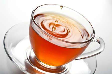 tea splash in glass cup