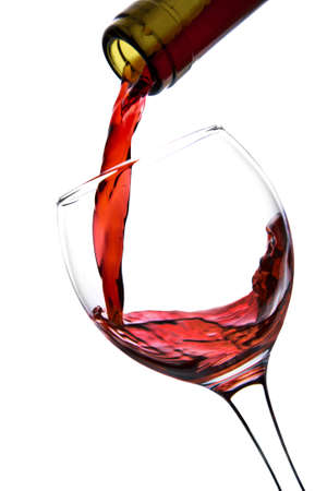 red wine pouring into glass isolated photo
