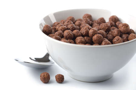 bowl with chocolate balls isolated photo