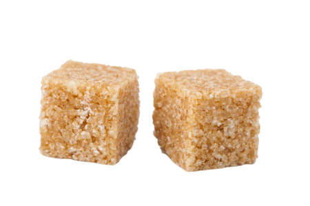sugary:  brown sugar cubes isolated