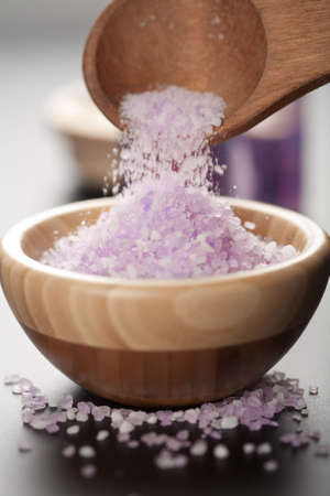 herbal salt in wooden bowl. spa and body care background