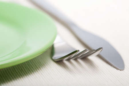 fork and knife near green plate Stock Photo - 4799958