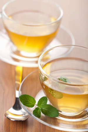 two cups of green tea with mint photo