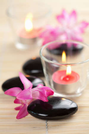 spa stones and pink flowers over bamboo mat Stock Photo - 4799963