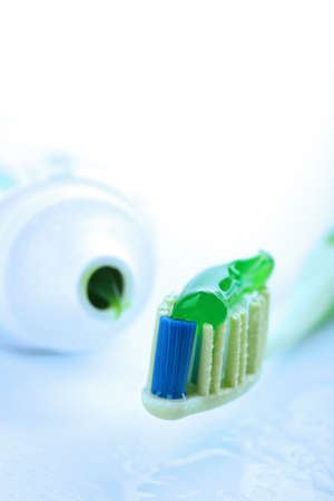 toothbrush with green toothpaste. dental care   photo