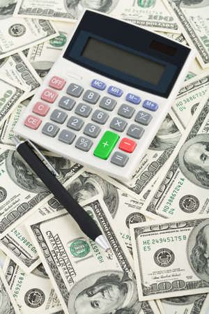 dollars and calculator photo