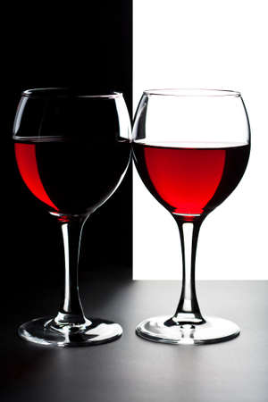 two glasses of red wine isolated photo